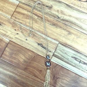 Long gold and black necklace